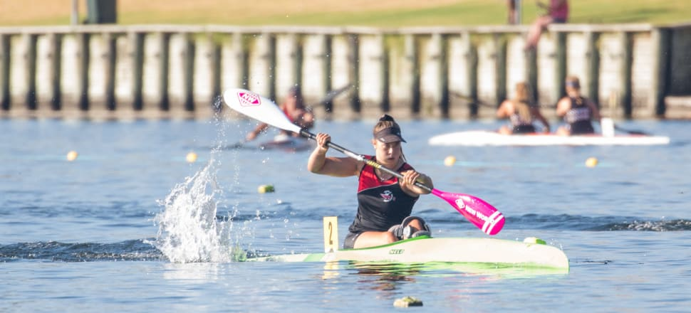 Olivia Brett won five gold medals in the U18 class at this year's national canoe sprint championships, even with her injured left knee in a large brace.  Photo: Jamie Troughton Dscribe Media.