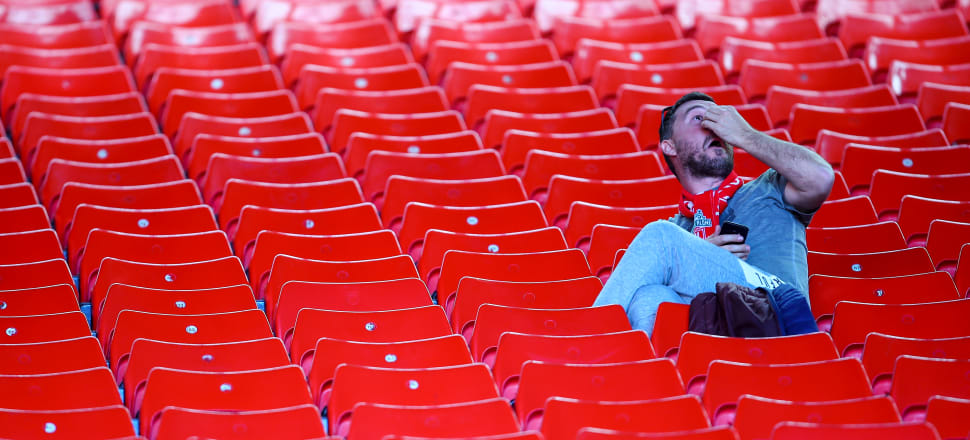 A Liverpool fan ponders how to get out of Anfield without walking alone after the final match of an almost awesome season. Photo: Getty Images