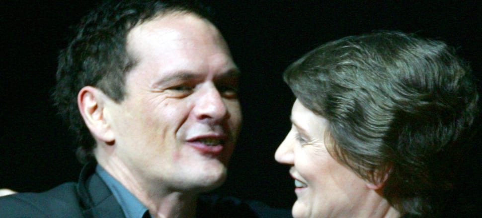 Shayne Carter collecting his lifetime achievement award from Helen Clark while losing his mind on E. Photo: Getty Images
