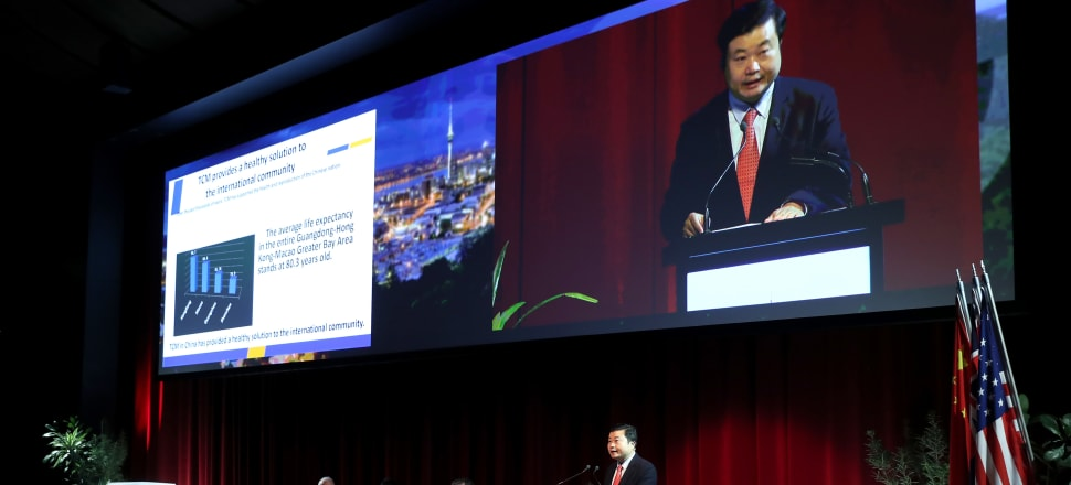 Li Chuyuan, chair of China's biggest pharmaceutical company, speaks at the Tripartite Economic Alliance meeting in Auckland. Photo: Supplied.
