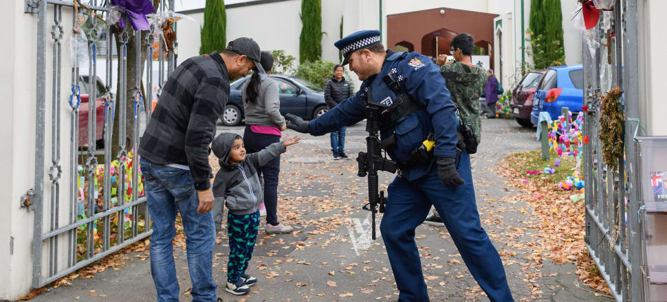 As Christchurch muslims arrive at the Al Noor mosque for the iftar, armed police are a stark reminder of how their community was torn apart. Photo: Getty Images
