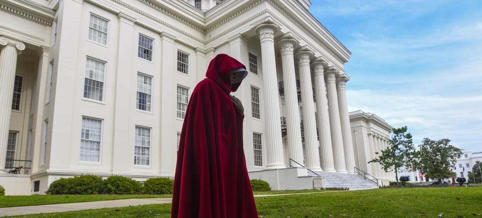 A protestor dressed as a character from the Handmaid's Tale marches against one of the US's most restrictive bans on abortion. Photo: Getty Images