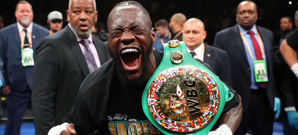 Deontay Wilder enjoys the moment after retaining his WBC heavyweight title thanks to a first round stoppage of Dominic Breazeale. Photo: Getty Images