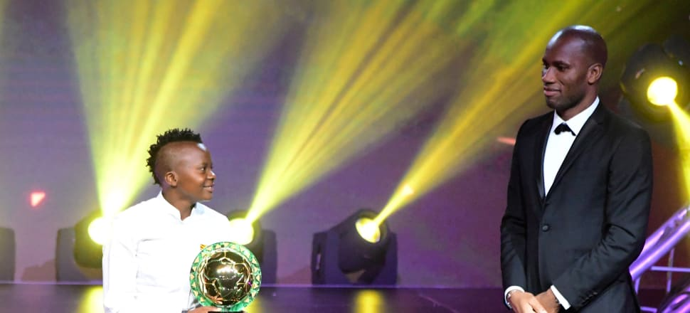 South Africa's Chrestinah Thembi Kgatlana receives the African  Women's Player of the Year trophy from Didier Drogba. Photo: Getty Images