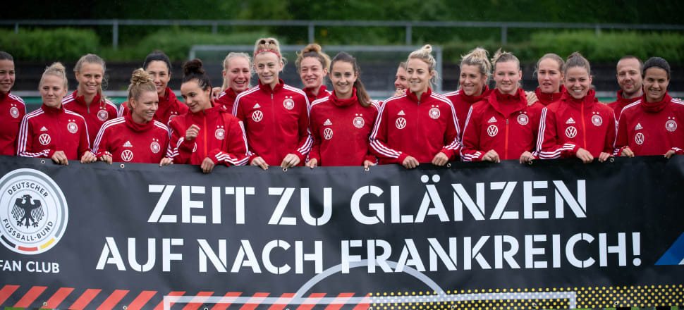 """The banner held by the No.2 ranked German team says: """"Time to shine - Let's go to France"""". Photo: Getty Images."""