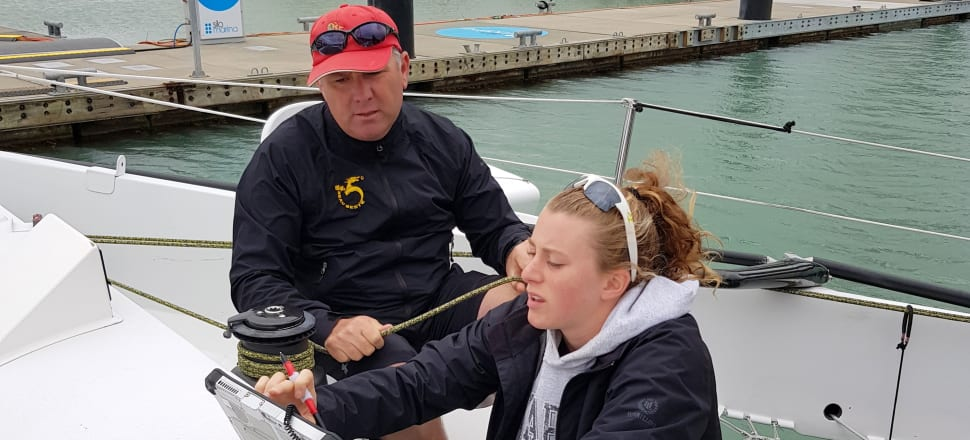 Beau Geste's young navigator Carrington Brady runs through the weather forecast with her skipper - and dad - Gavin Brady before their attempt to break the Coastal Classic record. Photo: PIC Coastal Classic.