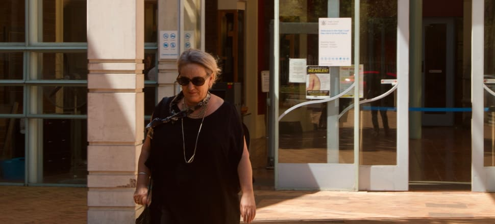 Newsroom investigations editor Melanie Reid leaves the High Court after giving evidence in the Peters leak case. Photo: Phill Prendeville.