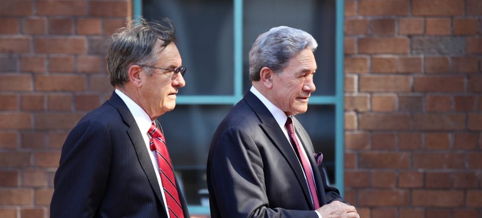 Winston Peters, right, outside the High Court in Auckland with lawyer Brian Henry. Photo: Getty Images