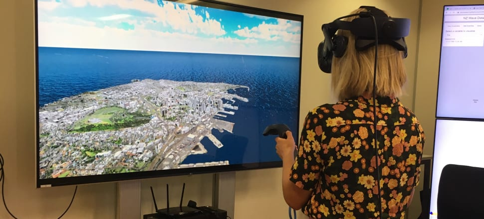 Reporter Eloise Gibson tries out Auckland University's virtual reality sea level rise simulator for Auckland. Photo: Supplied