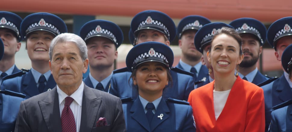 It was all smiles for the latest police graduates - but Jacinda Ardern and Winston Peters could not avoid less cheerful questions about the New Zealand First Foundation scandal. Photo: Sam Sachdeva.