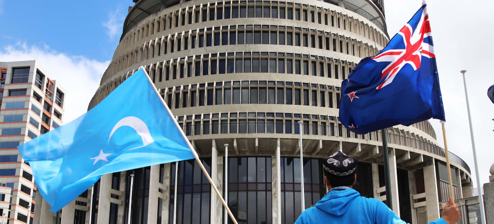 New Zealand's Uighur Muslim community has protested outside Parliament about China's treatment of the minority - but a New Zealand university is partnering with a Chinese AI firm providing surveillance technology in Xinjiang province. Photo: Lynn Grieveson.