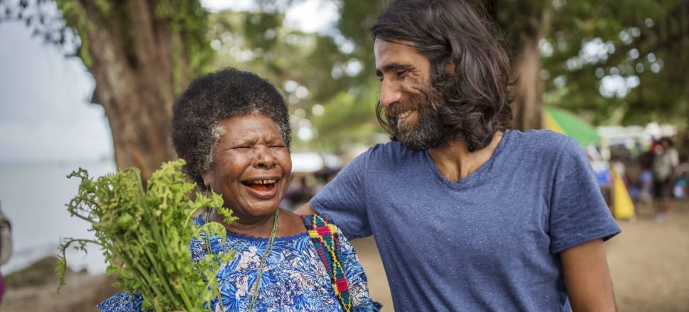 Behrouz Boochani with one of his local friends on Manus Island. Photo: Getty Images