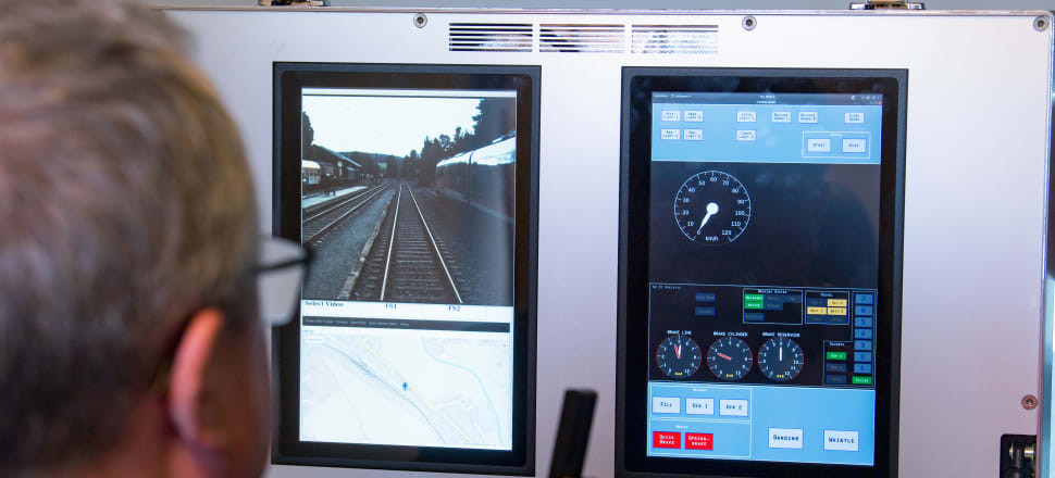 A railcar driver from the military and transport company Thales controls a 5G-powered railcar during a test drive at Schlettau station. Photo: Getty Images
