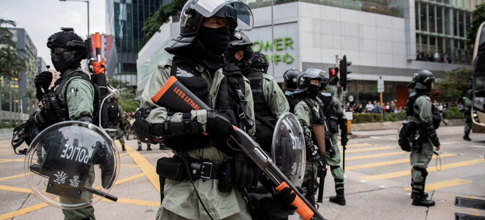 China's government has had to calculate whether the turmoil from the protests or the backlash from forced suppression would hurt its interests more.Photo: Getty Images
