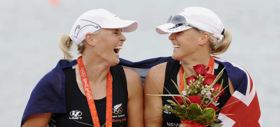 The incredible Evers-Swindell twins, Georgina and Caroline, share a giggle on the podium after winning double sculls gold at the 2008 Beijing Olympics. Photo: Getty Images.