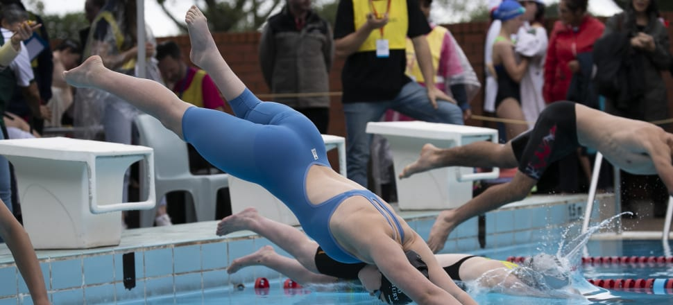 Ella Benn dives into the pool at King's College in Auckland during a race at the Halberg Games. Photo: Halberg Foundation.