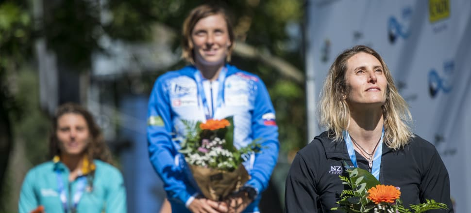 Luuka Jones soaks up her success at the canoe slalom world championships in Spain, standing on the podium for the first time, to collect bronze. Photo: Getty Images.