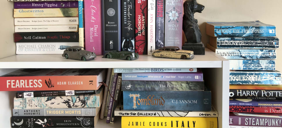 Toys, Harry Potter, and Emily Perkins: a bookshelf in the home of the celebrated children's author and illustrator, Donovan Bixley.