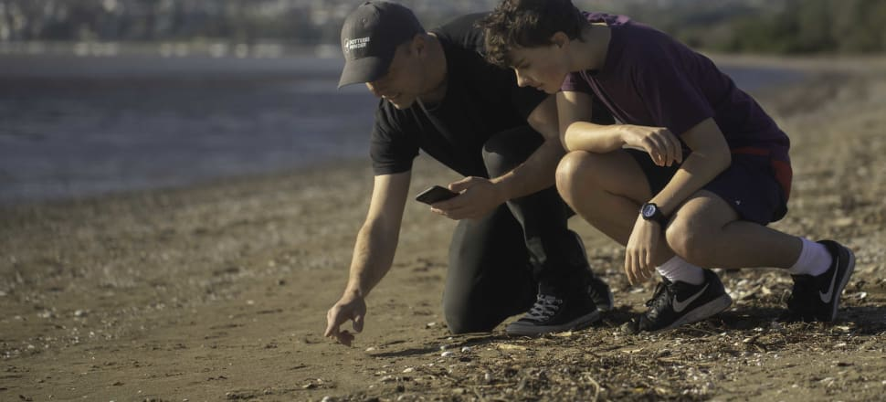 Shaun Lee deciphering shorebird clues. Photo: Supplied