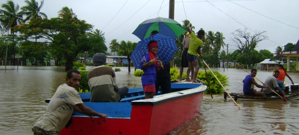 Fijians evacuate after flooding in 2012. Evacuations and rebuilds are increasingly common for Pacific island nations facing increased severe weather events. Photo: Supplied