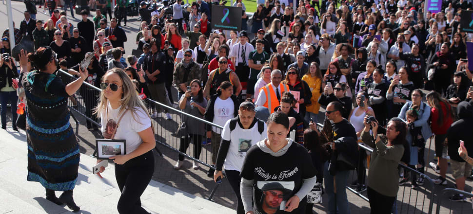 After a hikoi to Parliament in May, marchers broke through barriers to place on the steps photos of whānau members lost to suicide. The Government is now being criticised for not designing a suicide prevention plan specifically for  Māori. Photo: Lynn Grieveson