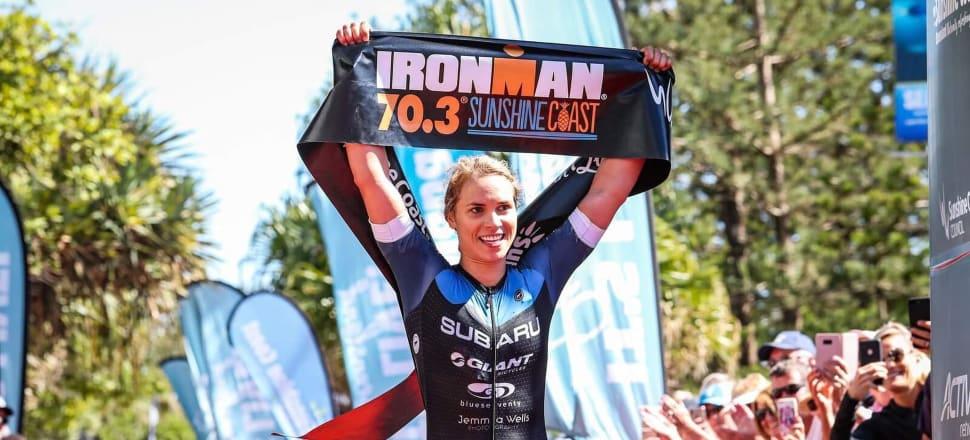 Dr Hannah Wells crosses the finish-line as the first woman home in the Ironman 70.3 Sunshine Coast last weekend. Photo: Tim Bardsley-Smith.