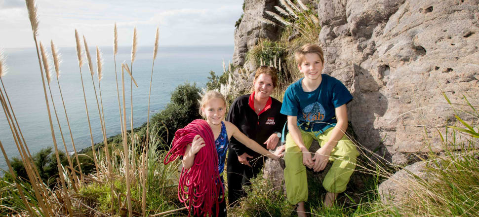 Vicki Semple, tournament director of the AIMS Games in Tauranga, with two keen young rock climbers. Photo: Jamie Troughton/Dscribe Media.