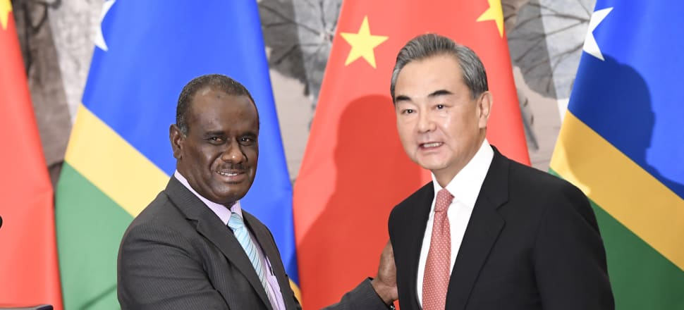 Solomon Islands Foreign Minister Jeremiah Manele with Chinese Foreign Minister Wang Yi in Beijing on Friday after the establishment of diplomatic ties.