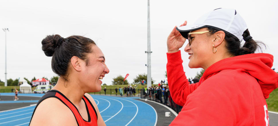 Lisa Adams (left) celebrates with her sister and coach Dame Valerie Adams after she set a new world record in para shot put at the NZ track and field champs in Christchurch this year. Photo: Getty Images.