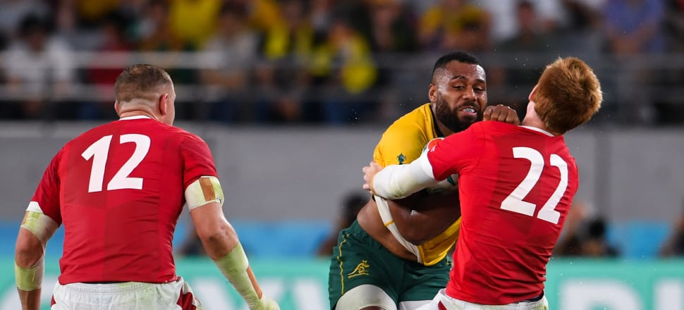 Australia's Samu Kerevi is penalised for leading with the arm in a tackle by Wales' Rhys Patchell. Photo: Getty Images.