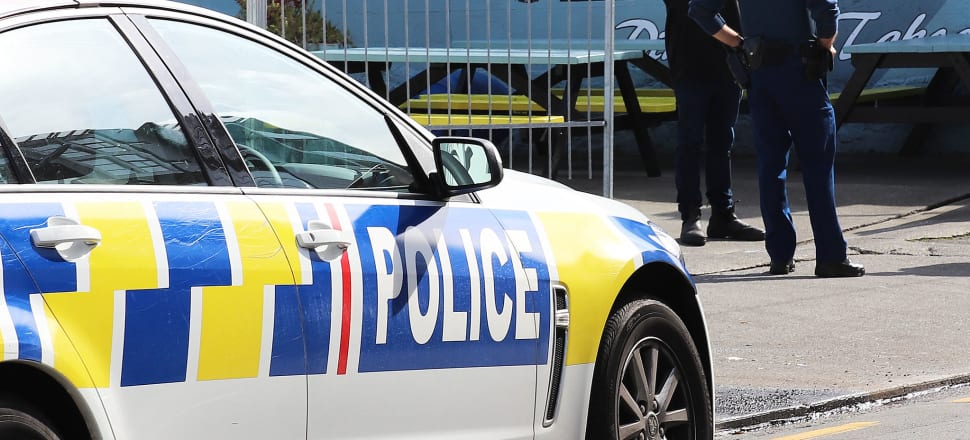 Police telling a Wellington fishmonger he must stop selling to the public. Photo: Lynn Grieveson