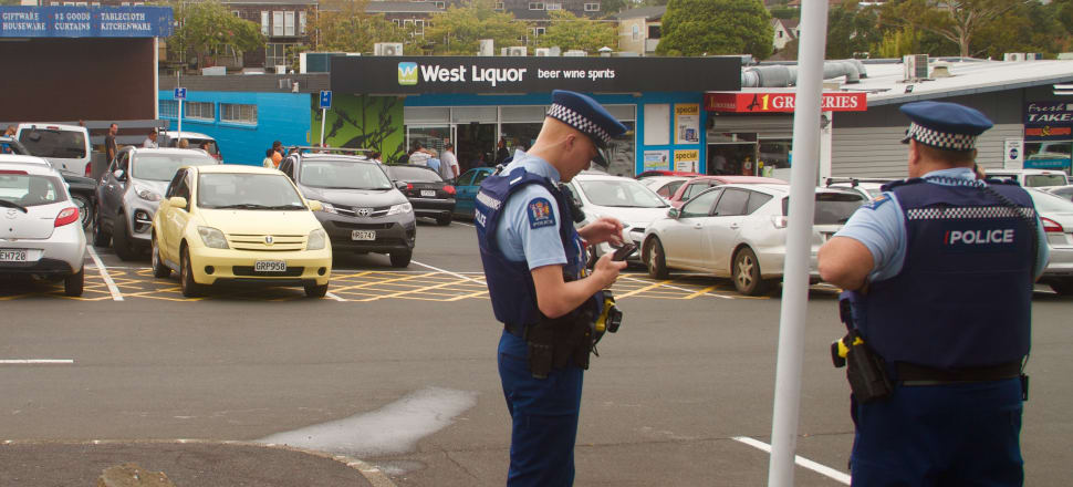 Police maintain an appropriate social distance from the thirsty throng. Photo: B O'Rourke