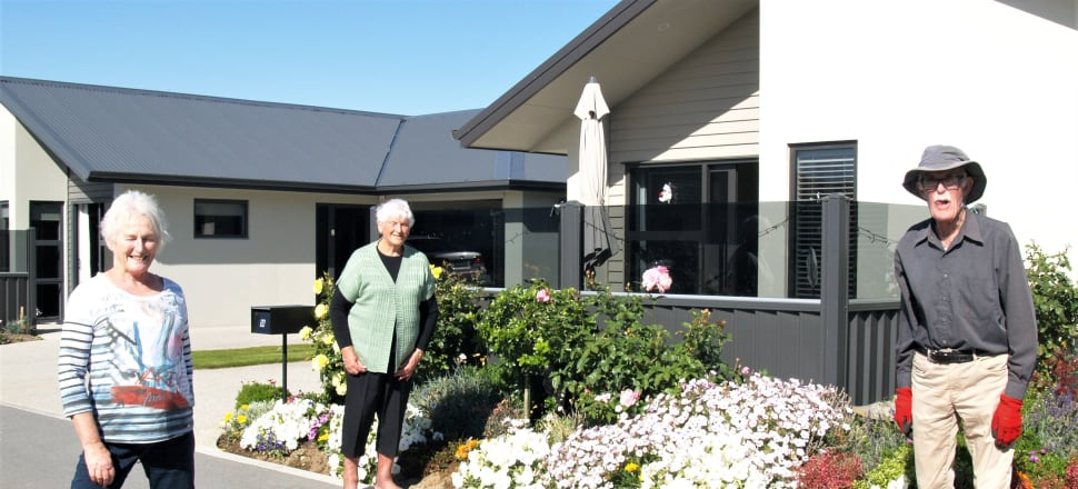 Village life under Covid 19 isn't daunting these Cromwell retirees…Dawn Buchanan (centre) catches up with Bernie Syamore (left) and Max O'Leary at Golden View Lifestyle Village in Cromwell. Photo: Supplied