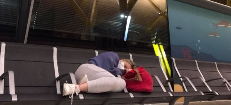 At airport: Rosie O'Hagan catching a nap at Madrid airport before the trek home to New Zealand. Photo: Supplied