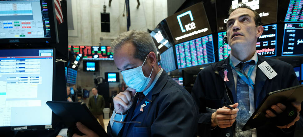 Traders work on the floor of the New York Stock Exchange on March 20. Trading on the floor has now become fully electronic to protect employees from spreading the coronavirus. Photo: Getty Images.