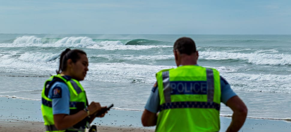 A barrelling wave at Wainui Gisborne, with police blocking access to the beach. Photo: Cory Scott nzsurfmag