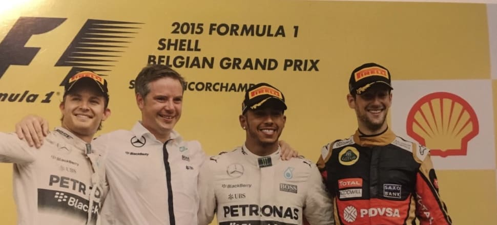 Michael Harre with Lewis Hamilton, on his left, after Hamilton won the 2015 Belgian Grand Prix. Nico Roseberg, who finished second is on the left of the photo and Romain Grosjean on the right. Photo: Michael Harre.