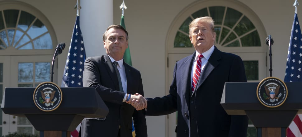 Brazil's President Jair Bolsonaro and US President Donald Trump didn't listen to experts on Covid-19. Photo: Getty Images