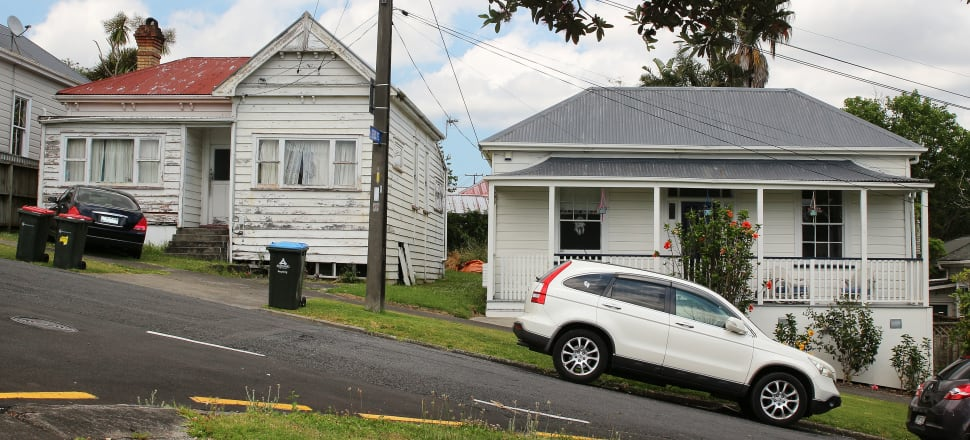 House price inflation is expected to go downhill in the next year, but how far and how fast. One run down and one renovated wooden villa weatherboard houses on a steep hilly street in Kingsland, Auckland. Photo by Lynn Grieveson