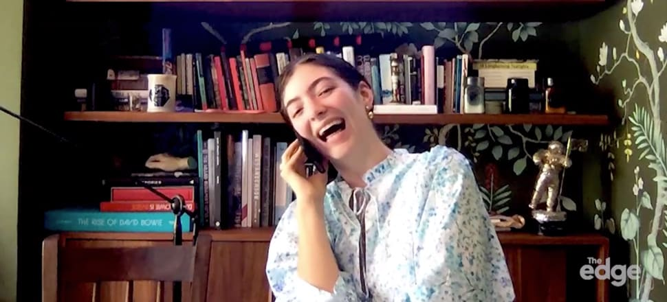 Lorde in front of her bookcase during a Skype call this week to The Edge radio station. Only one book title is visible - something about David Bowie - but ReadingRoom literary editor Steve Braunias invites the singer to DM him on the Twitter machine (or email stephen11@xtra.co.nz) to talk about some of her other books. Photo with permission of The Edge/MediaWorks