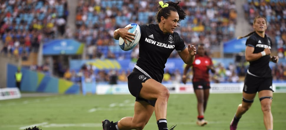 Before injury: Black Ferns Sevens try-scoring legend Portia Woodman in full flight during the 2018 Commonwealth Games - seven months before rupturing her Achilles. Photo: Getty Images.