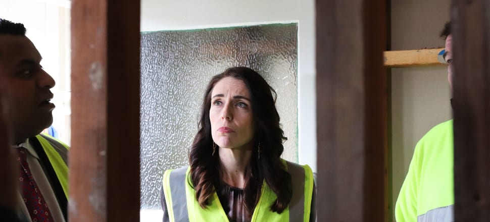 Prime Minister Jacinda Ardern has confirmed Labour will not propose significant tax and welfare policy change in its campaign for re-election. Ardern was in hi-vis at a Kāinga Ora announcement at a state house being retrofitted at Naenae. Photo: Lynn Grieveson