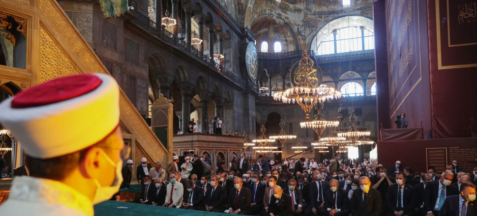 Turkey's President Recep Tayyip Erdogan and invited guests attend Friday prayers at Hagia Sophia Grand Mosque during the buildings first official prayers after being reconverted into a mosque. Photo: Turkish Presidential Press Office/Getty Images)