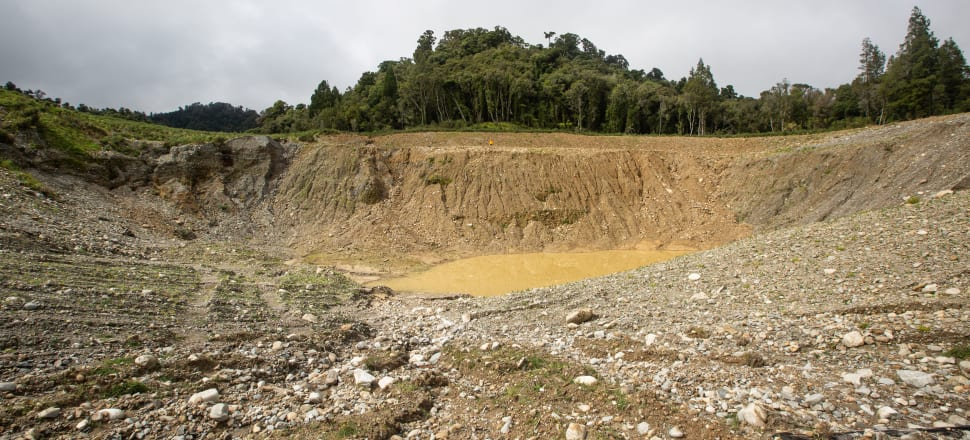 The Mikonui mine pit, in a photo taken in late March 2020, post rehabilitation. For scale, the orange dot is a person. Photo: Neil Silverwood