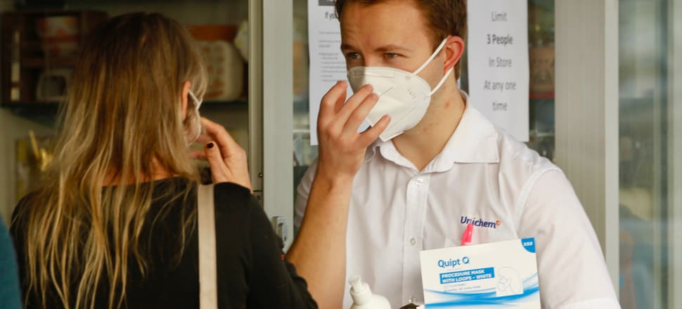 Demonstrating wearing a Covid-19 mask at Unichem, Manly. Photo: John Sefton