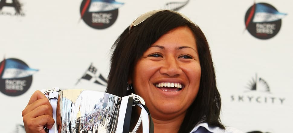 Former Kiwi Ferns captain Luisa Avaiki holding the women's rugby league World Cup her team won in 2008. Photo: Getty Images.