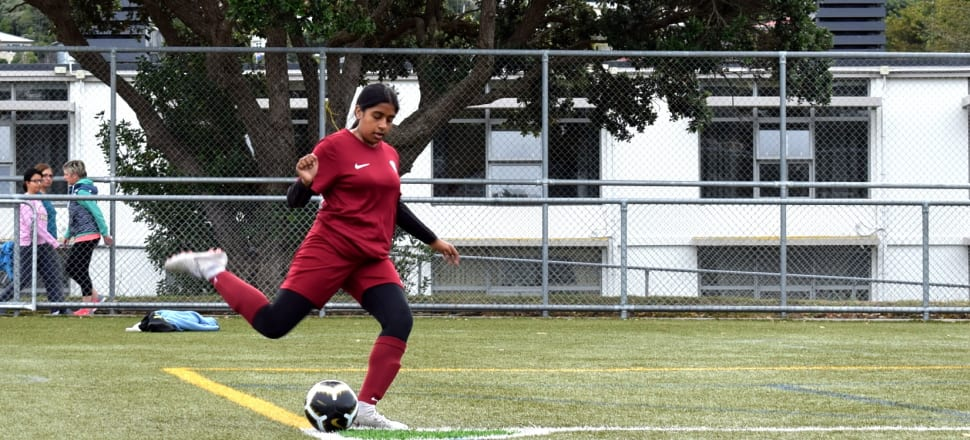 "Huda Anas, playing for North Wellington Football Club, wants to ""go the extra mile and use people of colour to represent the club... to make people feel more welcome"".  Photo: supplied."