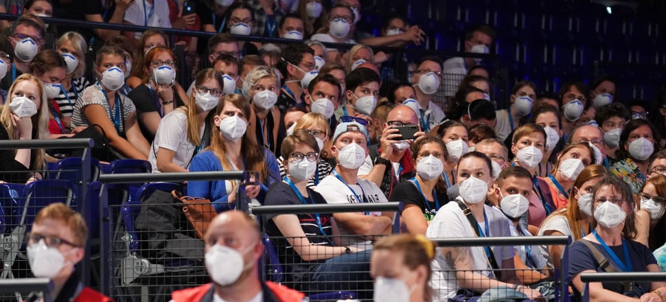 Participants wearing masks take part in a university study in Leipzig simulating restarting indoor events in Germany. Photo: Getty Images