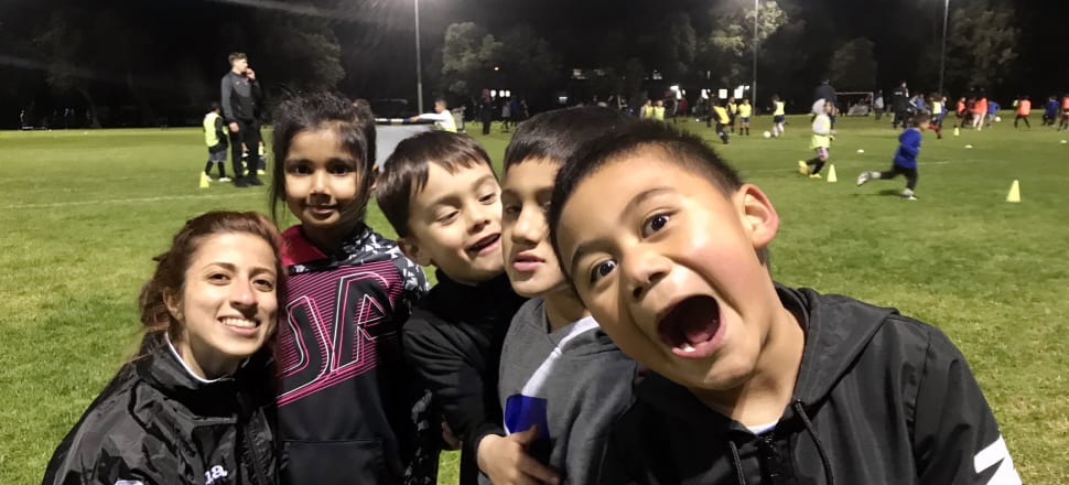 """After her first game of football just a few years ago - """"to get to know people"""" - Ola Shahin (left) is now playing competitively and coaching young kids at her Manukau United club. Photo: supplied."""