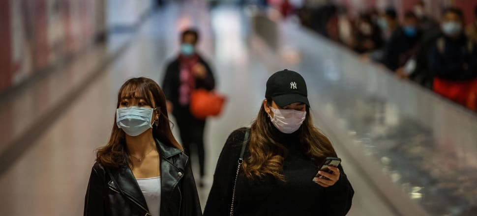 Among conspiracy theories about the virus are claims it's some kind of 'smokescreen' for illness caused by exposure to 5G. Photo: Getty Images